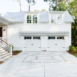 Inspiration for a country white two-story wood exterior home remodel in Charleston with a metal roof