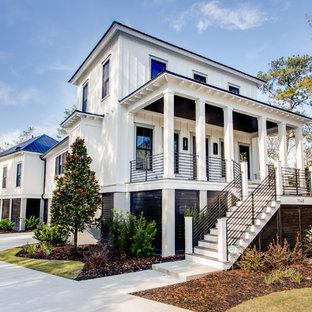 Inspiration for a contemporary white two-story exterior home remodel in Charleston