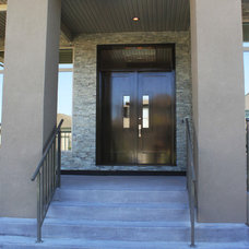 Contemporary Exterior by Realstone Systems