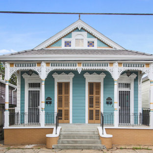 Inspiration for a small eclectic blue one-story vinyl exterior home remodel in New Orleans with a shingle roof