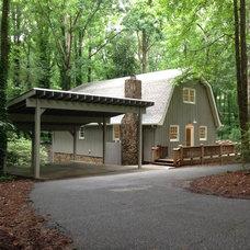 Farmhouse Exterior by JOMA Construction