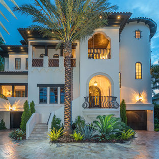 Tuscan beige three-story house exterior photo in Tampa