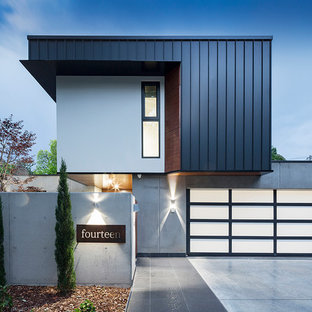 Design ideas for a modern two-storey grey exterior in Canberra - Queanbeyan with metal siding and a flat roof.