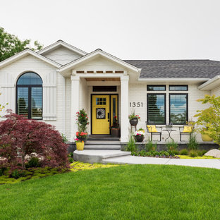 Transitional white one-story brick exterior home idea in Salt Lake City with a shingle roof