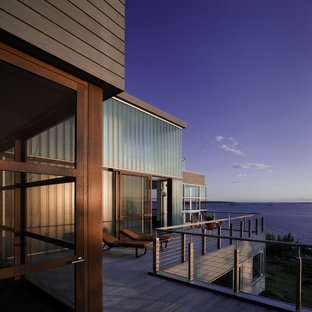 Example of a minimalist wood exterior home design in Portland Maine