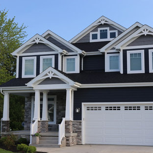 Deep navy house white trim Custom home with front porch