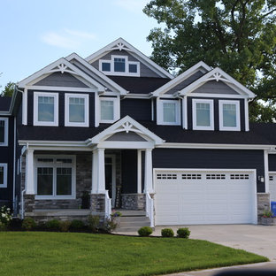 Large craftsman blue two-story wood exterior home idea in Chicago with a shingle roof