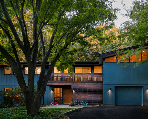 example of a mid sized midcentury modern blue two story wood exterior home design