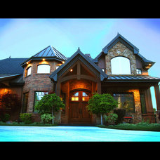 Eclectic Exterior by Gray Hawk Construction