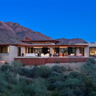 Inspiration for a large southwestern one-story flat roof remodel in Phoenix