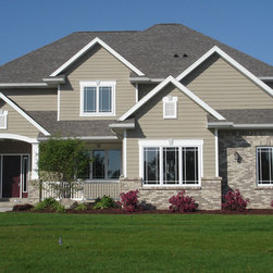 Omaha traditional beige house color exterior design ideas for Exterior remodel and design omaha