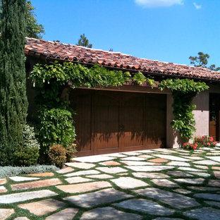 Imagen de fachada de casa beige, mediterránea, grande, de dos plantas, con revestimientos combinados y tejado de teja de madera