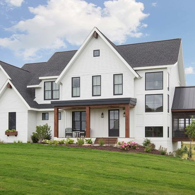 Country white two-story exterior home idea in Minneapolis with a shingle roof