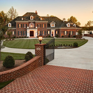 Inspiration for a timeless brick exterior home remodel in Charlotte