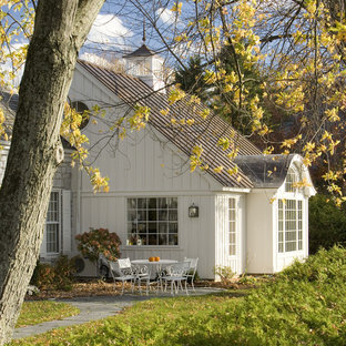Example of a mountain style white wood exterior home design in Burlington