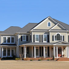 Traditional Exterior by OTM Designs & Remodeling Inc.