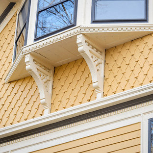 Inspiration for a victorian yellow wood exterior home remodel in Boston