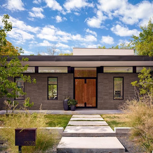Inspiration for a modern brown two-story flat roof remodel in Austin