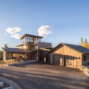 Large urban three-story mixed siding house exterior photo in Denver with a shingle roof