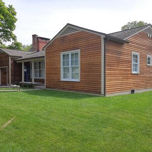 Idéer för ett mellanstort klassiskt oranget hus, med allt i ett plan