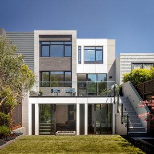 Idéer för funkis flerfärgade hus, med tre eller fler plan, blandad fasad och platt tak