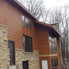 Rustic Exterior by Lindus Construction/Midwest LeafGuard