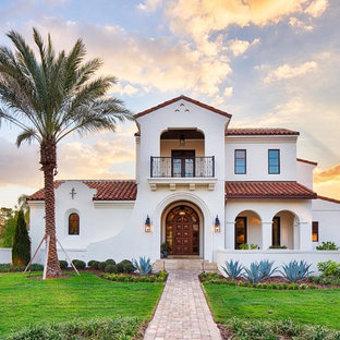 Inspiration for a white mediterranean two floor detached house in Orlando with a pitched roof and a tiled roof.