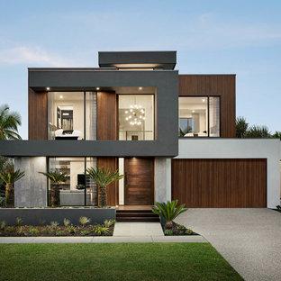 Источник вдохновения для домашнего уюта: двухэтажный, разноцветный частный загородный дом в современном стиле с комбинированной облицовкой и плоской крышей