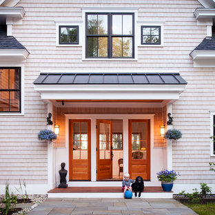 Design ideas for a traditional two-storey exterior in Portland Maine with wood siding.