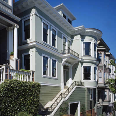 Ornate wood exterior home photo in San Francisco