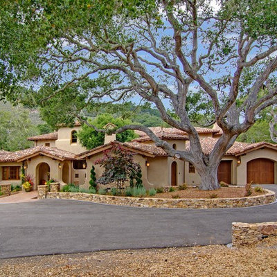 Large tuscan beige two-story stone gable roof photo in San Francisco with a tile roof