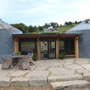 Inspiration for a small transitional one-story metal house exterior remodel in Other