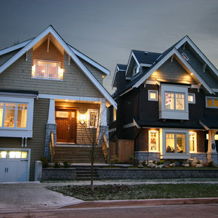 Example of a mid-sized arts and crafts gray two-story mixed siding exterior home design in Vancouver with a shingle roof