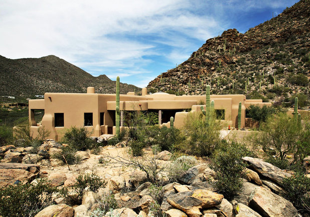 Roots of style pueblo revival architecture welcomes for Modern adobe houses