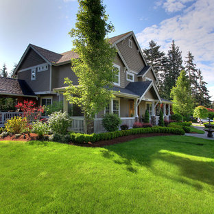 Inspiration for a mid-sized craftsman beige two-story wood exterior home remodel in Seattle with a shingle roof