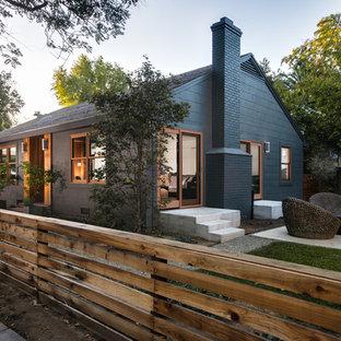 Small minimalist green two-story concrete fiberboard gable roof photo in Sacramento