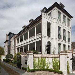 Traditional white three-story brick townhouse exterior idea in Charleston