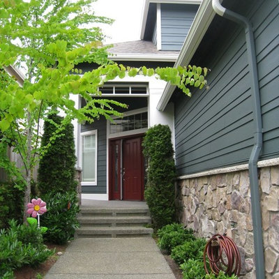 Arts and crafts green exterior home photo in Seattle