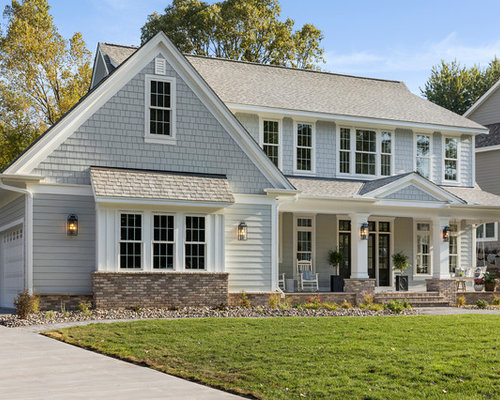 exterior house color schemes. Elegant gray two story gable roof photo in Minneapolis with a shingle Exterior House Color Combinations  Houzz