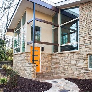Midcentury modern beige mixed siding exterior home photo in Atlanta