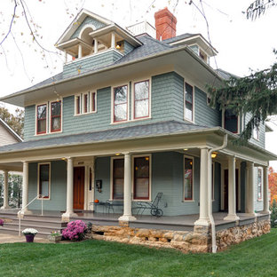 Inspiration for a timeless green three-story exterior home remodel in DC Metro