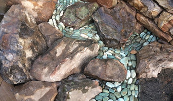 Dry laid patio with pebble stream and waterfall