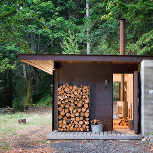 Design ideas for a small rustic one floor exterior in Vancouver with a lean-to roof.