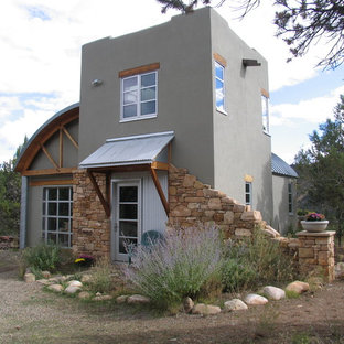 Example of an eclectic metal exterior home design in Denver