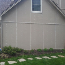 Traditional Exterior by DIAMOND CONTRACTING INC