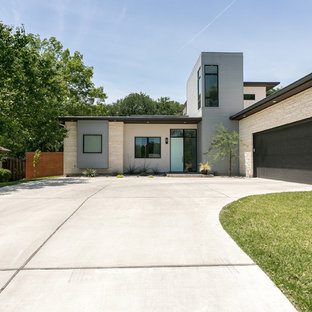 Inspiration for a contemporary multicolored one-story mixed siding house exterior remodel in Austin