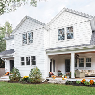 Inspiration for a mid-sized timeless white two-story wood exterior home remodel in Boston with a shingle roof