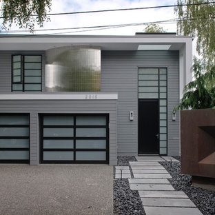 Example of a trendy gray two-story wood exterior home design in Seattle