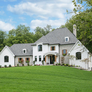 Large transitional white two-story mixed siding house exterior idea in Cincinnati with a hip roof and a shingle roof