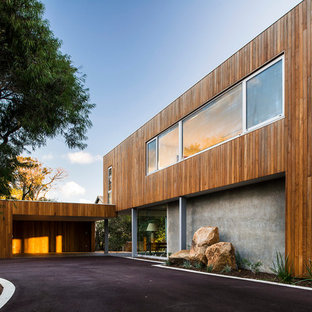 Design ideas for a large modern two-storey exterior in Perth with wood siding and a flat roof.